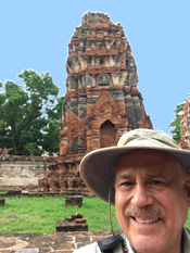 Stephen Cervantes by a wat in Thailand