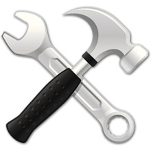 Iconized, illustrated hammer and wrench, crossed to form an X
